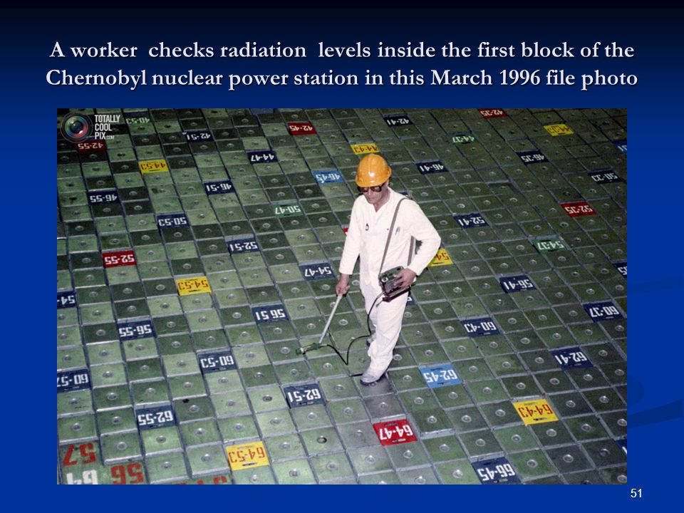 A worker checks radiation levels inside the first block of the Chernobyl nuclear power station in this March 1996 file photo