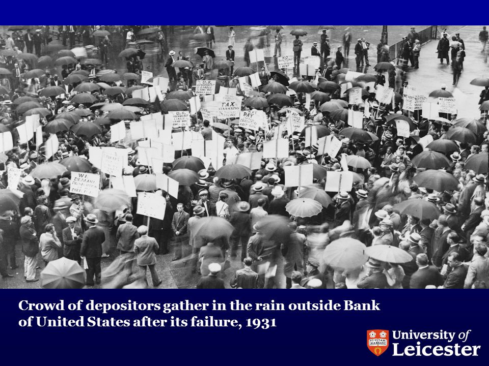 Crowd of depositors gather in the rain outside Bank of United States after its failure, 1931
