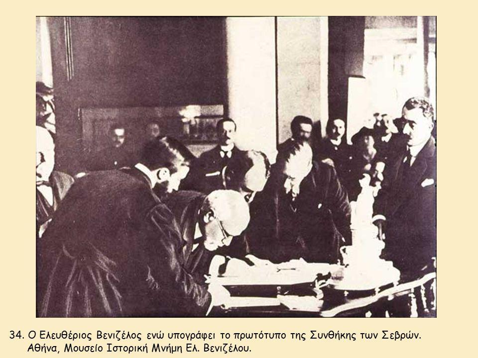 34. Ο Ελευθέριος Βενιζέλος ενώ υπογράφει το πρωτότυπο της Συνθήκης των Σεβρών.